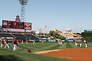 ANAHEIM, CA - APRIL  23:  Members of the Los Angeles Angels of Anaheim warm up before the game between the Boston Red Sox and the Los Angeles Angels of Anaheim on Saturday, April 23, 2011 at Angel Stadium in Anaheim, California. The Red Sox won the game in a 5-0 shutout. (Photo by Paul Spinelli/MLB Photos via Getty Images)