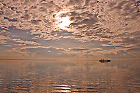 Boat out in the bay with morning clouds in Bali, Indonesia