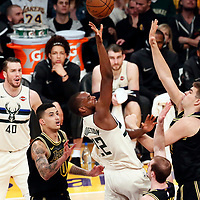 30 March 2018: Milwaukee Bucks forward Khris Middleton (22) goes for the floater shot over Los Angeles Lakers center Ivica Zubac (40) during the Milwaukee Bucks 124-122 victory over the LA Lakers, at the Staples Center, Los Angeles, California, USA.