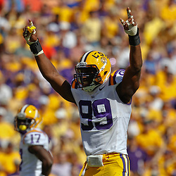October 8, 2011; Baton Rouge, LA, USA;  LSU Tigers defensive end Sam Montgomery (99) against the Florida Gators during the first quarter at Tiger Stadium.  Mandatory Credit: Derick E. Hingle-US PRESSWIRE / © Derick E. Hingle 2011