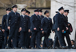 © Licensed to London News Pictures. 14/12/2017. London, UK. Members of the London Fire Brigade arrive at St Paul's Cathedral in London for a Grenfell Tower National Memorial Service to mark the six month anniversary of the Grenfell Tower fire. The service is attended by survivors of the fire and relatives of those who lost their lives in the fire, as well as members of the emergency services and members of the Royal family.  Over 70 people were killed when a huge fire ripped though 24-storey Grenfell Tower block in west London in June 2017.   Photo credit: Ben Cawthra/LNP