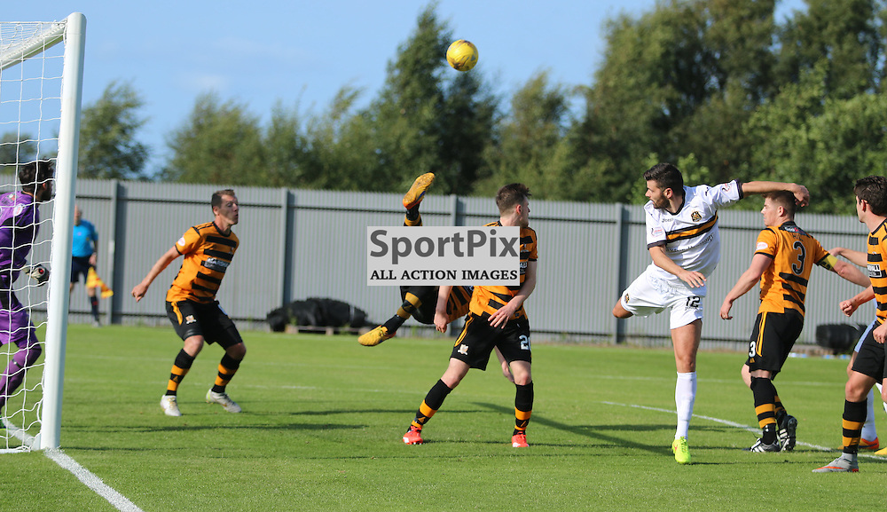 Alloa defence clears in style during the Dumbarton FC v Alloa FC Scottish Championship 5th September 2015 <br /> <br /> (c) Andy Scott | SportPix.org.uk