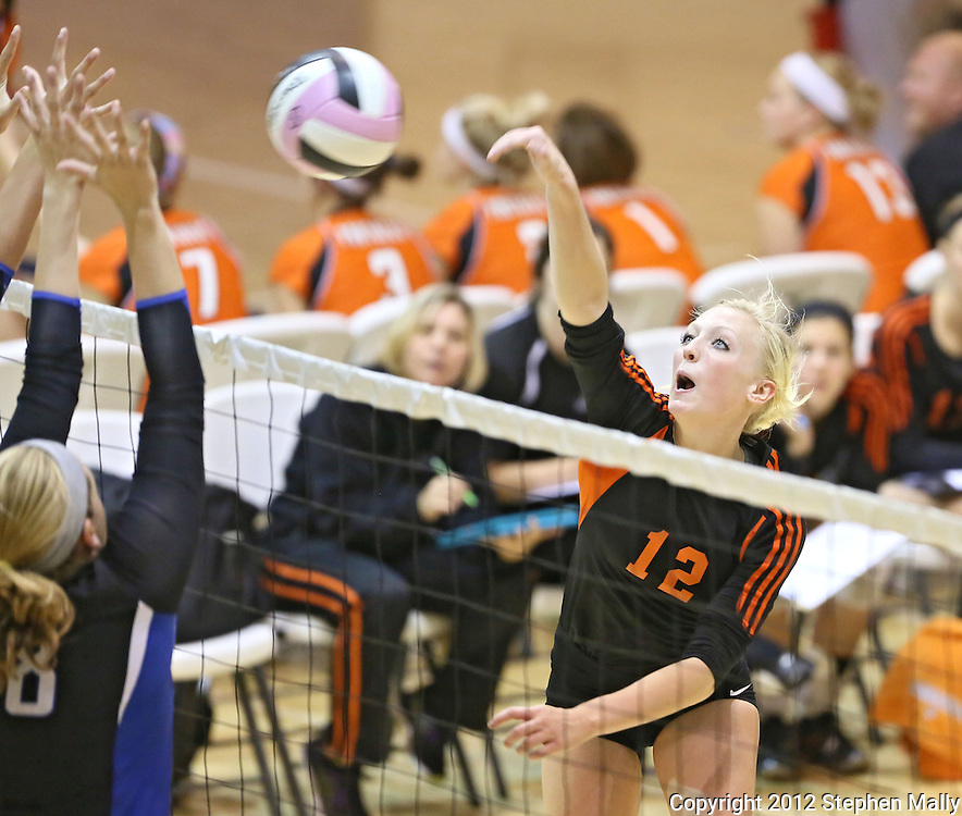 West Delaware's Paige Soppe (right) tries to spike the ball around Dike-New Hartford's Ashley Dumler during their game against Dike-New Hartford at the Westside Volleyball Invitational at Jefferson High School in Cedar Rapids on Saturday October 6, 2012. Dike-New Hartford defeated West Delaware 25-13 and 25-23.