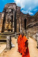 Headless Buddha statue, Lankatilaka Vihara , Ruins of ancient city, Polonnaruwa, Sri Lanka.