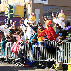 24 February 2009: Revelers scream for throws during the Zulu parade along the St. Charles Avenue parade route throwing beads, painted coconuts and various trinkets on Mardi Gras day in New Orleans, Louisiana. Mardi Gras is an annual celebration that ends at midnight with the start of the Catholic Lenten season which begins with Ash Wednesday and ends with Easter..