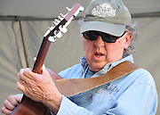 Dan Sorenson plays acoustic guitar in the Blue Desert Band's concert at the 2012 Tucson Folk Festival.