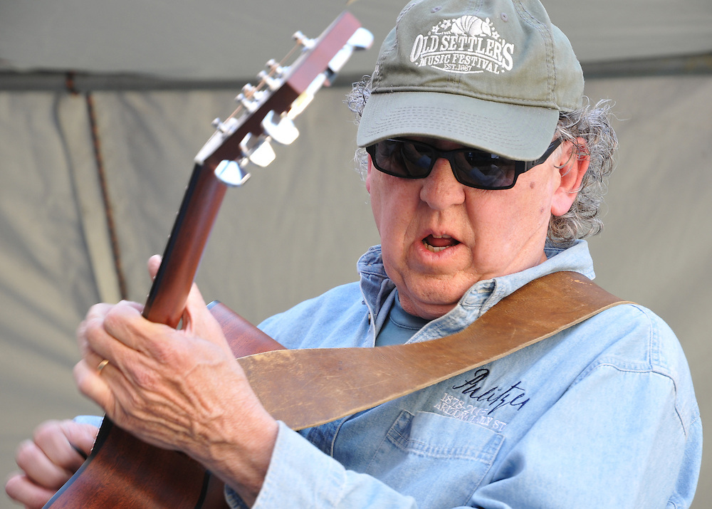 Dan Sorenson plays acoustic guitar in the Blue Desert Band's concert at the 2012 Tucson Folk Festival. Event photography by Martha Retallick