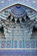 Detail of ceiling of monumental arch, Gur-Emir Mausoleum, 1417-20, Samarkand, Uzbekistan, pictured on July 14, 2010, in the afternoon. Gur-Emir Mausoleum, or Tomb of the Ruler, was built by Timur in 1404 for his favourite grandson, Mohammed Sultan, and became the mausoleum for the Timurid dynasty. Samarkand, a city on the Silk Road, founded as Afrosiab in the 7th century BC, is a meeting point for the world's cultures. Its most important development was in the Timurid period, 14th to 15th centuries. Picture by Manuel Cohen.