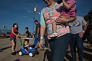 OCALA, FL - MAY 14, 2016:  <br /> <br /> Brandie Stalnaker (cq) of Ocala, Fla. pushes her son Landyn Durbin (cq), 9 mos., through the pit area in a car-shaped stroller at Bubba Raceway Park in Ocala, Fla. She's there to support her brother, driver Mike Stalnaker. <br /> <br /> (Melissa Lyttle for the New York Times)