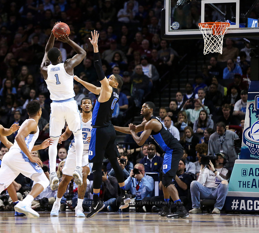 North Carolina forward Theo Pinson (1) shoots a three over Duke forward Jayson Tatum (0) during the semifinals of the 2017 New York Life ACC Tournament at the Barclays Center in Brooklyn, N.Y., Friday, March 10, 2017. (Photo by David Welker, theACC.com)