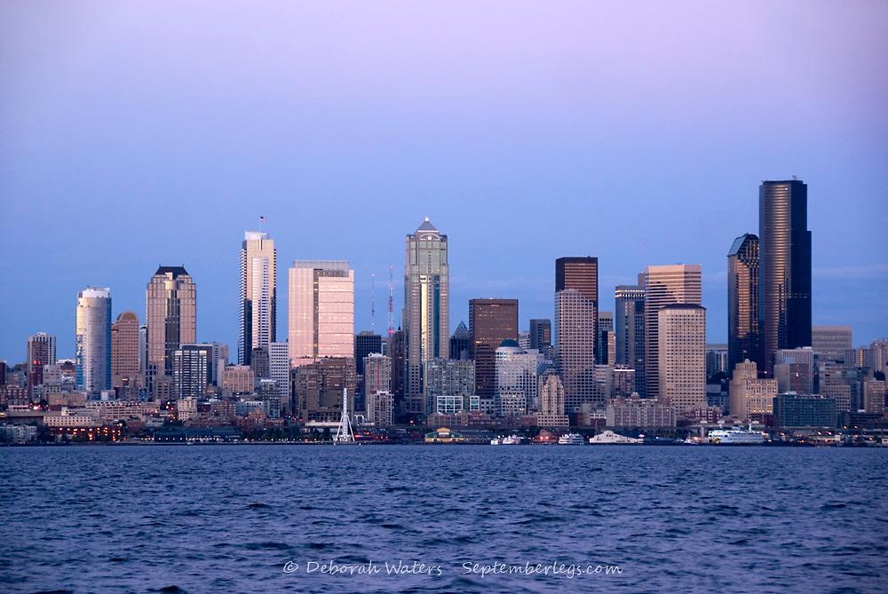 Downtown Seattle skyscrapers viewed across Elliott Bay from Alki at dusk, West Seattle, USA