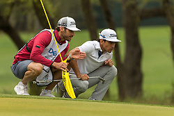March 23, 2018 - Austin, TX, U.S. - AUSTIN, TX - MARCH 23:  R. Cabrera Bello and his caddie look over a putt during the WGC-Dell Technologies Match Play Tournament on March 22, 2018, at the Austin Country Club in Austin, TX.  (Photo by David Buono/Icon Sportswire) (Credit Image: © David Buono/Icon SMI via ZUMA Press)