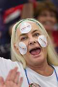 A supporter of Republican presidential candidate billionaire Donald Trump decorates her face with stickers before the start of a campaign rally at the Myrtle Beach Convention Center November 24, 2015 in Myrtle Beach, South Carolina.