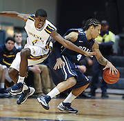 Drexel's Frantz Massenat tries to steal the ball from Old Dominion's Dimitri Batten during the first half at the Daskalakis Athletic Center in Philadelphia.