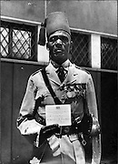 An Nubian officer of the King's African Rifles holds his invitation to a Garden Party at the Government House of Nairobi in honor of HRH Princess Margaret of England.  Nubians were recognized and invited to such events when members of the British Royal family visited Kenya.  (1956)