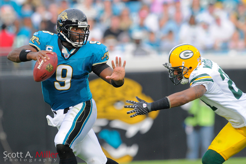 Dec. 14, 2008; Orlando, FL, USA; Jacksonville Jaguars quarterback David Garrard (9) scrambles away from Green Bay Packers cornerback Charles Woodson (21) during the second half of the Jags 20-16 win at Jacksonville Municipal Stadium. Mandatory Credit: Scott A. Miller-US PRESSWIRE...©2008 Scott A. Miller