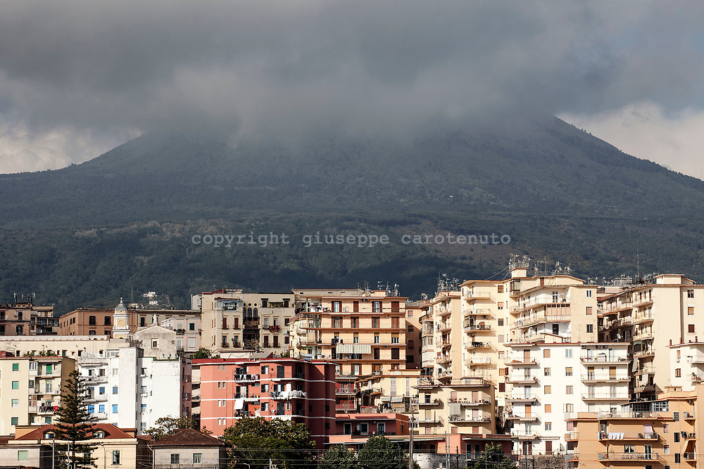 15 May 2017, Torre del Greco, Naples Italy - A view of a part the city of Torre del Greco from the port. The city of Torre del Greco is within the national plane of evaquation in case of eruption of Vulvano Vesuvius and this is the first city with a high number of inhabitants, about 85000. Located in the red zone instituted by Italian Government for the national evacuation plan in case of eruption of the Vesuvio.