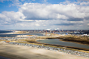 Nederland, Noord-Holland, IJmuiden, 16-04-2008; huisjes op het IJmuiderstrand, in de achtergrond het terrein van Corus (voorheen Hoogovens, gefuseerd met British Steel) in Velsen-Noord en haven van IJmuiden; havengebied, strandhuisjes, zee, dagrecreatie, nachtrecreatie;holiday cottages on the beach,harbour entrance, mouth of North Sea canal; .Corus steel industry in the backgroud;  Corus is part of the Tata Steel Group and produces hot-rolled, cold-rolled and metallic-coated steels; steel, iron, coke, ore, coal, cokes, chimney, blast furnaces...  .luchtfoto (toeslag); aerial photo (additional fee required); .foto Siebe Swart / photo Siebe Swart