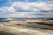 Nederland, Noord-Holland, IJmuiden, 16-04-2008; huisjes op het IJmuiderstrand, in de achtergrond het terrein van Corus (voorheen Hoogovens, gefuseerd met British Steel) in Velsen-Noord en haven van IJmuiden; havengebied, strandhuisjes, zee, dagrecreatie, nachtrecreatie;holiday cottages on the beach,harbour entrance, mouth of North Sea canal; .Corus steel industry in the backgroud;  Corus is part of the Tata Steel Group and produces hot-rolled, cold-rolled and metallic-coated steels; steel, iron, coke, ore, coal, cokes, chimney, blast furnaces...  .luchtfoto (toeslag); aerial photo (additional fee required); .foto Siebe Swart / photo Siebe Swart