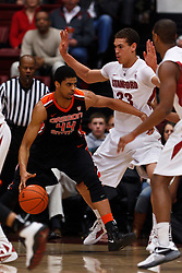 Feb 16, 2012; Stanford CA, USA; Oregon State Beavers forward Devon Collier (44) is defended by Stanford Cardinal forward Dwight Powell (33) during the first half at Maples Pavilion.  Mandatory Credit: Jason O. Watson-US PRESSWIRE