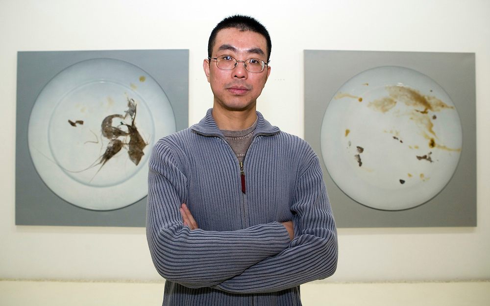 """Zhu Yu, Chinese painter and performance artist, poses for a photograph during an interview at Xin Art gallery in   Beijing, China, on Thursday, April 3, 2008. Zhu is notorious for his work, """"Eating People,"""" which shows the artist purportedly cooking and eating a human fetus."""