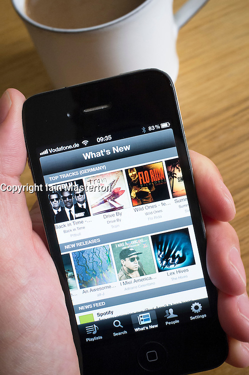 Looking at Spotify digital music streaming homepage on an iPhone smartphone