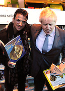 © Licensed to London News Pictures. 06/12/2011, London, UK. (R )BORIS JOHNSON and (L) PETER ANDRE launch  the Love Libraries scheme at Shepherds Bush Library, London, Today 6th December. Love Libraries is a new scheme to encourage Londoners to read and participate in activities at their local libraries. Photo credit : Stephen Simpson/LNP