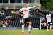 Fulham midfielder, Kevin McDonald pointing during the Pre-Season Friendly match between Fulham and Crystal Palace at Craven Cottage, London, England on 30 July 2016. Photo by Matthew Redman.
