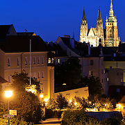 Prague Castle at dusk with a walkway