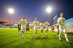 PODGORICA, MONTENEGRO - Wednesday, August 12, 2009: Wales' Neal Eardley, David Cotterill and Sam Vokes warm-up wearing a shirt in support of former captain John Hartson who is battling against cancer, and to promote awareness of men's health issues with web site checkemlads.com, before an international friendly match against Montenegro at the Gradski Stadion. (Photo by David Rawcliffe/Propaganda)