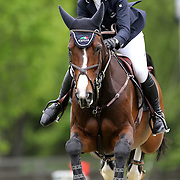 NORTH SALEM, NEW YORK - May 21: McKayla Langmeier riding Classic Care in action during The $15,000 Under 25 T & R Development Grand Prix at the Old Salem Farm Spring Horse Show on May 21, 2016 in North Salem, New York. (Photo by Tim Clayton/Corbis via Getty Images)