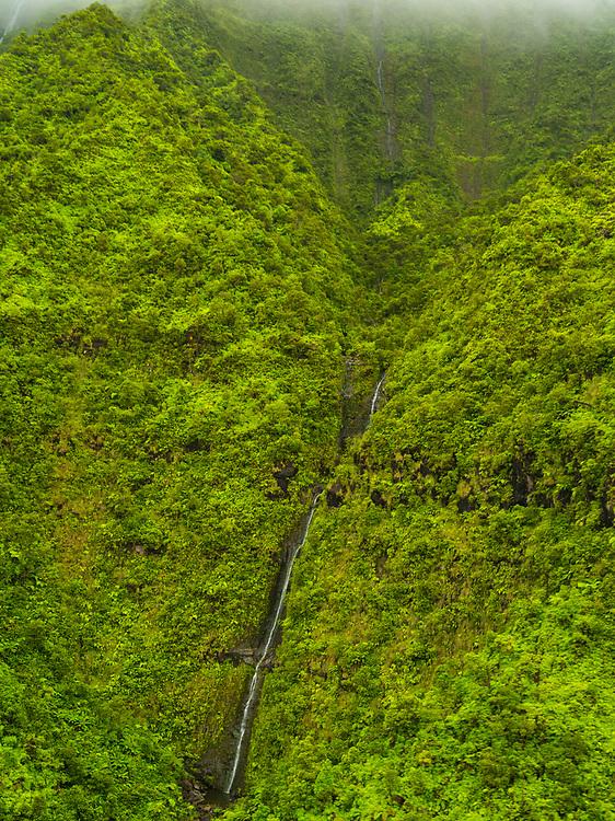 Aerial view of Namolokama Falls, Kauai, Hawaii on a cloudy day.