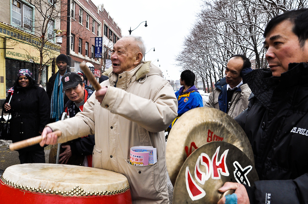 An elderly and experienced lion dance drummer takes over the drums accompanying the Lion Dance. Chinese New Year, Chinatown, Chicago, February 6th, 2011