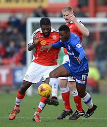Gillingham's Jermaine McGlashan battles with Crewe Alexandra's Anthony Grant  - Photo mandatory by-line: Richard Martin-Roberts - Mobile: 07966 386802 - 10/01/2015 - SPORT - Football - Crewe - Alexandra Stadium - Crewe Alexandra v Gillingham - Sky Bet League One