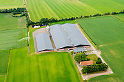 Nederland, Noord-Brabant, Gemeente Veghel, 26-06-2014;  <br /> Erp, Boerdonksedijk, Grootschalige varkensfokkerijen in Brabant. Megastallen.<br /> Large-scale pig farming in mega stables.<br /> luchtfoto (toeslag op standaard tarieven);<br /> aerial photo (additional fee required);<br /> copyright foto/photo Siebe Swart.