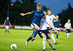 LLANELLI, WALES - Monday, August 19, 2013: England's Meaghan Sargeant in action against France's Sandie Toletti during the Group A match of the UEFA Women's Under-19 Championship Wales 2013 tournament at Stebonheath Park. (Pic by David Rawcliffe/Propaganda)