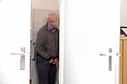 senior man standing in toilet room