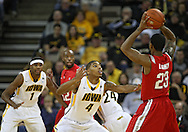 January 04 2010: Iowa Hawkeyes guard/forward Roy Devyn Marble (4) defends Ohio State Buckeyes guard/forward David Lighty (23) during the first half of an NCAA college basketball game at Carver-Hawkeye Arena in Iowa City, Iowa on January 04, 2010. Ohio State defeated Iowa 73-68.