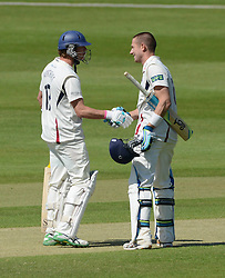 Joe Denly celebrates scoring a century against Gloucestershire County Cricket with co bats man Sam Northeast  - Photo mandatory by-line: Dougie Allward/JMP - Mobile: 07966 386802 - 21/05/2015 - SPORT - Cricket - Bristol - County Ground - Gloucestershire v Kent - LV=County Cricket