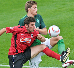23.07.2010, Stadion Friedengrund, Villingen, GER,   Werder Bremen vs SC Freiburg T Friendly Match  1. FBL 2010  im Bild Peter Niemeyer ( Werder #25 ) gegen Stefan Reisinger ( Freiburg #27 )    EXPA Pictures © 2010, PhotoCredit: EXPA/ nph/  Kokenge+++++ ATTENTION - OUT OF GER +++++ / SPORTIDA PHOTO AGENCY