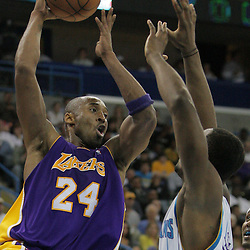 12 November 2008:  Los Angeles Lakers guard Kobe Bryant (24) looks to pass as New Orleans Hornets center Hilton Armstrong (12) guards him during a NBA regular season game between the Los Angeles Lakers and the New Orleans Hornets at at the New Orleans Arena in New Orleans, LA..