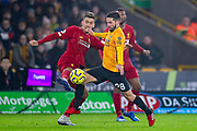 Liverpool forward Roberto Firmino (9) tussles with Wolverhampton Wanderers midfielder João Moutinho (28) during the Premier League match between Wolverhampton Wanderers and Liverpool at Molineux, Wolverhampton, England on 23 January 2020.