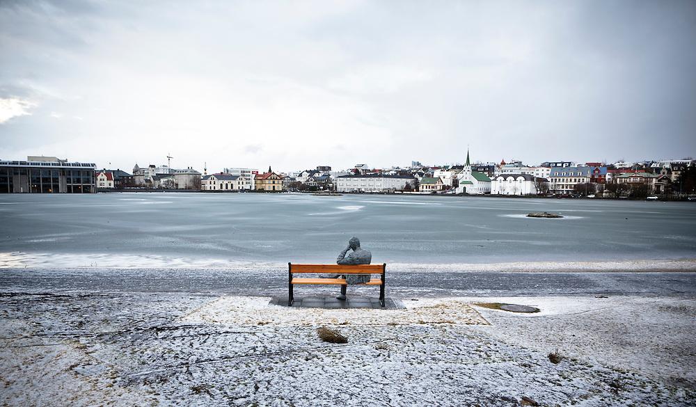A statue in front of Reykjavik pond