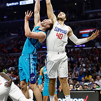 LOS ANGELES, CA - OCT 28: Ivica Zubac (40) of the LA Clippers blocks Cody Zeller (40) of the Charlotte Hornets during a game on October 28, 2019 at the Staples Center, in Los Angeles, California.