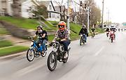 Jordan Uttecht of Lincoln, in orange helmet, and Conan Modrzynski, left, ride with other moped'ers on Saturday, April 15, 2017, in Omaha.<br /> <br /> MATT DIXON/THE WORLD-HERALD