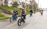 Jordan Uttecht of Lincoln, in orange helmet, and Conan Modrzynski, left, ride with other moped'ers on Saturday, April 15, 2017, in Omaha.<br /> <br /> MATT DIXON/THE WORLD-HERALD