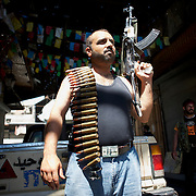 August 14, 2012 - Aleppo, Syria: A Free Syria Army (FSA) fighter prepares to head to the frontline in Aleppo's old city. The Syrian Army have in the past ten days increased their attacks on residential neighborhoods where Free Syria Army rebel fights have their positions in Syria's commercial capital, Aleppo.