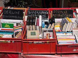 Secondhand political and historical books for sale at bohemian cafe and bookshop Tasso on Karl Marx Allee in former East Berlin in Germany