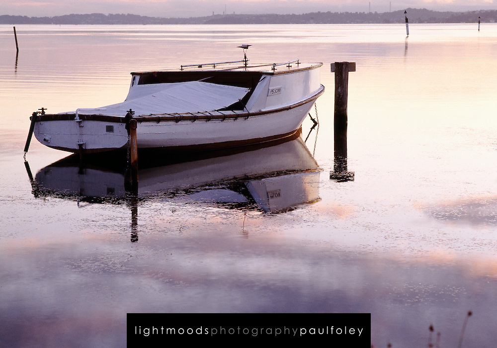 Old Fishing Boat at sunset, unused since professional fishing was banned on Lake Macquarie (East Coast Australia). The fishing ban has greatly increased stocks for amateur fishers in this holiday destination