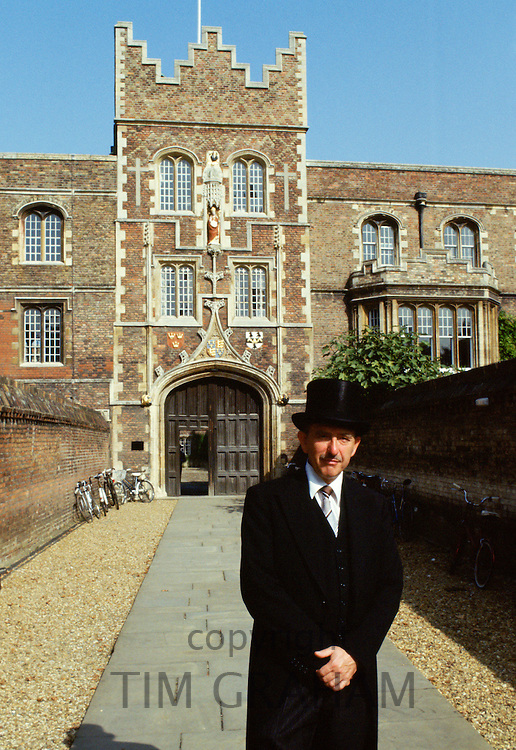 Porter in traditional top hat and tails at Jesus College, Cambridge University, England, UK